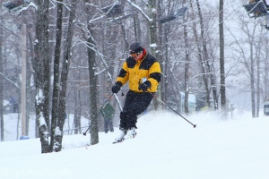 Downhill skier with snow